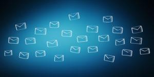 Mail envelopes against blue background. Copyright: sdecoret / 123RF Stock Photo